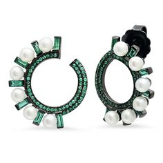Colette's emerald, pearl and blackened gold Huggies wrap around the ear to create an unconventional hoop. Discover how to wear modern pearl jewellery in a cool new, young way: http://www.thejewelleryeditor.com/jewellery/how-to-wear-pearls-2016/ #jewelry