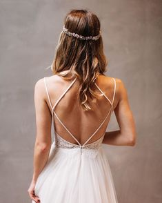 Our favorite emerging bridal trend? The return of spaghetti straps! They're romantic, fashion-forward, and make a stunning back statement. @livvylandblog embraced the trend at her recent #BHLDNhouston appointment, slipping into the Rosalind Gown to snap a pic. (photo by @kayrahhhhh   link in profile to shop)