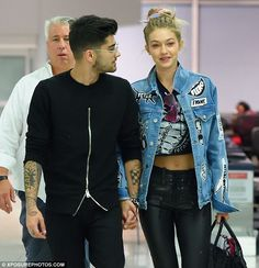 Cute couple: Gigi and Zayn held hands as they arrived at JFK Airport together