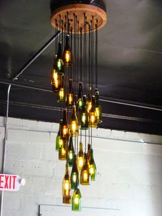 This was a custom 25 light wine bottle chandelier. There are 25 wine bottle lights hanging in a long spiral. The ceiling mount is 2 feet in circumference (Bottle Lights Design) Beer Bottle Crafts, Wine Bottle Art, Lighted Wine Bottles, Diy Bottle, Bottle Lights, Beer Bottles, Wine Bottle Lighting, Glass Bottle, Beer Bottle Chandelier