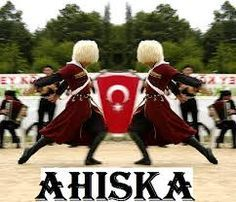 Ahiska Turks. We kind of have our flag but we're really similar with the Turks of Turkey as we are both Osmanli, so you'll see mostly Turkish flags when it comes to Ahiska Turks.  The male is posed in a lezginka stance, which is the most popular dance of the Caucasus region