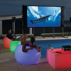 Glow Outdoor Chairs, around the pool & we can set up are Movie Theater outside also on a hot summer night