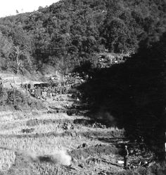 WWII soldiers bivouacked in terraced fields for the night in Burma. Photographer Unknown
