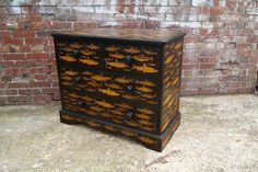 Decoupage Fish on a Chest of Drawers