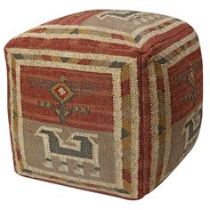 Crafted from jute and wool and filled with foam beads, this casual pouf ottoman softens your decor. The upholstery features intricate tribal motifs in shades of red, taupe and gold for a warm look.