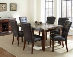 Montibello Marble Top Dining Room Set (TABLE+6CHAIRS+SERVER) $1279.99   ******In Store Pick up If not in the Dallas Area******   Contact Jay Kemp for additional information and questions regarding warranty.   Like us on Facebook for specials that we have going on and for additional information on products check us out at http://www.knoxfamilyfurniture.net
