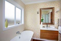 A DIY stenciled master bathroom accent wall using the Lily Scroll Allover Stencil from Cutting Edge Stencils. http://www.cuttingedgestencils.com/scroll-stencil.html