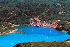Lakka harbour, #Paxos, with the famous Sunsail boats out on the tide.