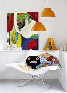 homes - kids: white chair with toys and orange lampshades