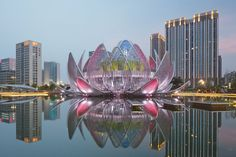"""The Lotus Building by Studio505 Architecture and design firm Studio505, have recently completed the Lotus Building in Wujin, China. """"Located in the heart of Wujin, the burgeoning southern district of Changzhou, Jiangsu PRC, the Lotus Building and the 3.5 hectare People's Park has been designed to act as a cultural anchor and civic landmark – establishing a symbolic commitment of the local government's ambitions and future aspirations."""