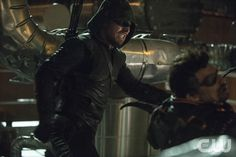 "Arrow -- ""Unthinkable"" -- Image AR223b_ 0241b -- Pictured (L-R): Stephen Amell as The Arrow and Manu Bennett as Slade Wilson -- Photo: Cate Cameron/The CW -- � 2014 The CW Network, LLC. All Rights Reserved.pn"