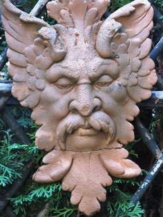 green man cast concrete stained to look like terra-cotta