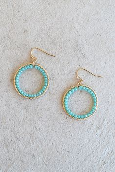 What goes around comes around and we hope these turquoise colored beaded beauties bring you nothing but style and endless compliments time and time again. These mini gold hooped earrings feature turqu