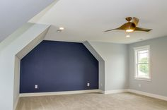 Master bedroom with a dark blue #accentwall #Gardenbrook