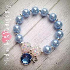 Beautiful NEW Cinderella bracelets! The blue acrylic pearls are the perfect shade of blue...