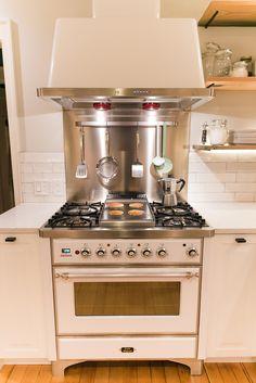 White Ilve range with hood and backsplash. 36'' White, modern farmhouse kitchen.