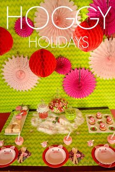 Hoggy Holidays Christmas Party Table.  The pink pipe cleaner twisted to look like a pigtail holding the utensils is too cute!  Our #burtonandburton #myownpet pig balloons would be the perfect addition to this party! #holidays #pig_party