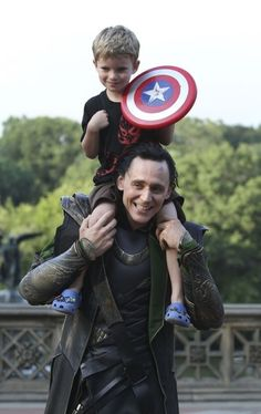Loki with  little Captain America.. Tom Hiddleston is an amazing person.
