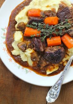 """Theres something incredibly comforting about Beef and Stout Stew served on top of a velvety heap of mashed potatoes. The stout loses its strong """"beer taste"""" and melds into a richly flavorful sauce. food and drink Beer Recipes, Irish Recipes, Soup Recipes, Cooking Recipes, Scottish Recipes, British Food Recipes, English Recipes, Recipies, Hp Sauce"""