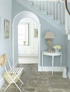 Powder blue walls You don't have to use a white background to create a bright hallway. These powder blue painted walls contrast with flagstone flooring to give a country cottage feeling.