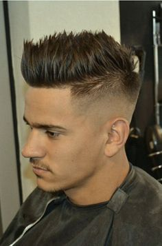Haircut. Faux hawk spilky. I might try this :)