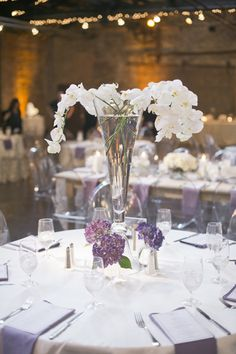 Lavender modern chic wedding with Ghost Chairs - round tablescape