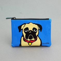 Marc Tetro  Pug Makeup Bag: The Pug Makeup Bag by Marc Tetro icomes in a glossy blue colour and the cartoon style pug print. The make-up pouch comes in bright blue made from PVC with a super cute pug printed on both sides. The lining is made from cotton and has funky black and white stripes. The makeup bag fastens with a zip printed with the Marc Tetro logo.