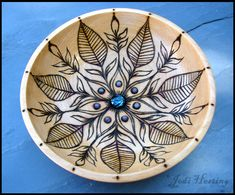 """""""Hokulani"""" wooden bowl that I burned a lotus design into and set gemstones and sparkling dichroic glass cabochon into the center. My bowls are available on my website www.beadworx.com"""