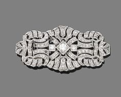 A diamond brooch, circa 1930 Of geometric openwork design, millegrain-set to the centre with three brilliant-cut diamonds, and throughout with single-cut diamonds