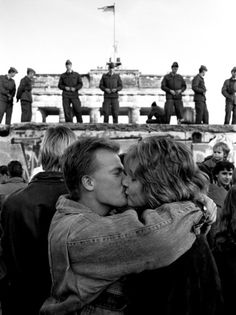 Berlin, Germany...The Berlin Wall. West Berliners kiss in front of the Brandenburg Gate, with East German border guards standing on top of the Berlin Wall, Nov 14,1989. One of the most emotional things I've been a part of in my life was being there when this wall was torn down.