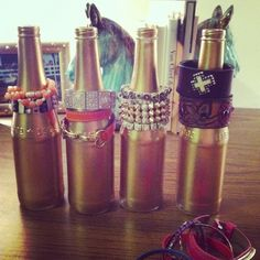 Spray Painted beer bottles as bracelet & bangle holders.