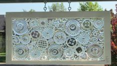 Repurpose old dishes onto a window frame...This would be even better with colored glass dishes to resemble a stained glass window:-).