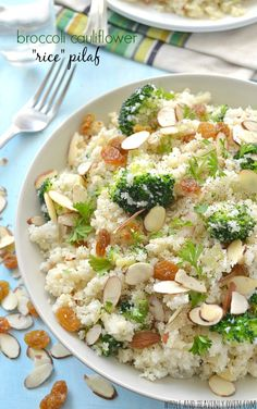 You won't believe that this simple rice pilaf is made primarily with one secret ingredient: Cauliflower! Unbelievably fluffy and jam-packed with tender broccoli, crunchy almonds and soft golden raisins. Rice Dishes, Veggie Dishes, Food Dishes, Rice Recipes, Vegetarian Recipes, Cooking Recipes, Healthy Recipes, Dinner Recipes, Broccoli Cauliflower