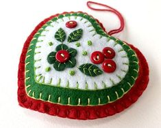 Holly heart felt Christmas ornament, Red & Green heart Holiday ornament with holly berries Holly heart felt Christmas ornament, Red & Green heart felt Holiday ornament, Handmade felt heart Ch Christmas Sewing, Handmade Christmas, Christmas Diy, Hallmark Christmas, Outdoor Christmas, Christmas Christmas, Christmas Photos, Felt Christmas Decorations, Felt Christmas Ornaments