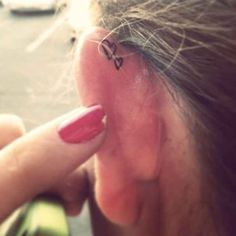 Didn't read the link. Just like this back of the ear tattoo idea...