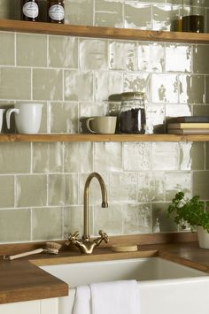 Mere field tiles in an offset pattern From the Cosmopolitan range at The Winchester Tile Company Handmade ceramic tiles made in the UK # Kitchen Wall Tiles, Kitchen Shelves, Kitchen Backsplash, Kitchen Cabinets, Backsplash Ideas, Dark Cabinets, Colourful Kitchen Tiles, Kitchen Sink, Patterned Kitchen Tiles