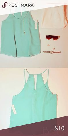"""Turquoise blouse Breathable and elegant blouse. The back has a """"V"""" cutout, and the straps sit around the collar bone. This item is NWT! Tops Blouses"""