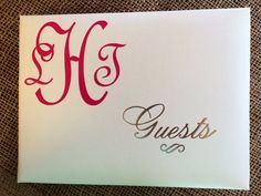 His and her monogram in adhesive vinyl to jazz up a guest book.