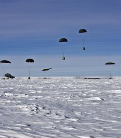 Pallets of cargo are airdropped over Amundsen-Scott South Pole Station.