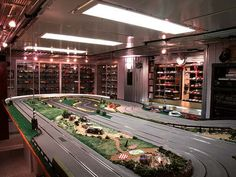 """on their own, they are nothing fabulous but this is where the phrase 'the sum of its parts is greater than its whole' really comes true. a couple of well-placed ikea hacks transform joe kelly jr's basement into a fabulous car room. joe tells me, """"i have a model car collection in my basement, and …"""