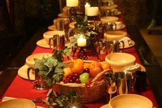 Medieval dinner with fruit in baskets on tables