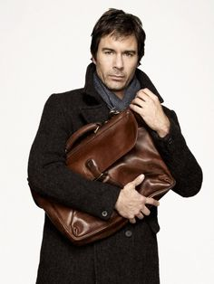 Eric McCormack as Dr. Daniel Pierce in Perception.  He's always clutching his bag like this. :)  Great TV show.