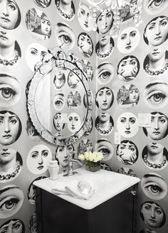 Bathroom with Fornasetti wallpaper by Cole and Son. Patterned wallpaper in a small loo or space works!