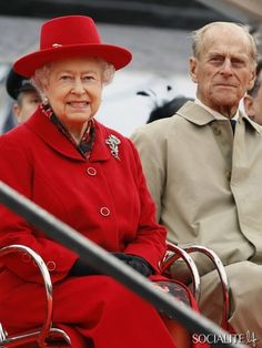 Queen Elizabeth II and Prince Philip, Duke of Edinburgh watch a presentation during a visit to the Cutty Sark in Greenwich, London on 25 April, 2012.