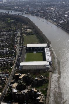 #Fulham's Craven Cottage teeters on the bank of the Thames in its pre-Michael Jackson days. #London