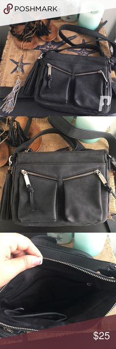 Charming Charlie Crossbody Purse Matte black crossbody purse with long buckle strap and zipper pockets. Great condition Charming Charlie Bags Crossbody Bags