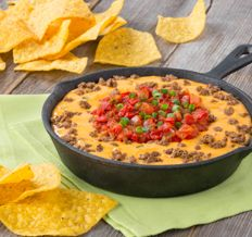 Beef Queso Fundido Dip - Create the tastiest Beef Queso Fundido Dip, Tostitos® own Beef Queso Fundido Dip with step-by-step instructions. Make the best Beef Queso Fundido Dip for any occasion. Dip Recipes, Mexican Food Recipes, Beef Recipes, Cooking Recipes, Party Recipes, Mexican Dishes, Copycat Recipes, Yummy Recipes, Yummy Food