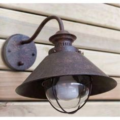 Borough Wharf Illuminate your garden or porch with this traditional outdoor wall light, showcasing a rusted iron design which adds a rustic touch to any space. Outdoor Wall Lamps, Outdoor Wall Sconce, Outdoor Walls, Bollard Lighting, Barn Lighting, Outdoor Lighting, Outside House Colors, Buy Lamps, Black House Exterior
