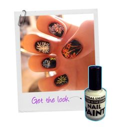 Jenny Pasha created this festive New Year's–inspired look by painting a black base over the nails and using a striping brush to create a firework pattern. To give your digits some extra oomph, she suggests incorporating glow-in-the-dark polish into the design.     SHOP NOW: Astral Lights Glow in the Dark Nail Paint, $4