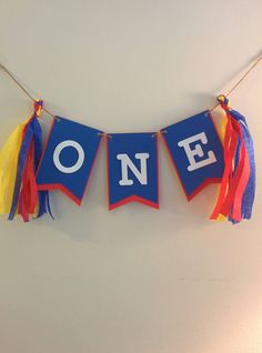 One banner with streamers / photo props / first birthday / superman inspired / circus theme by TheCCakeAccent on Etsy https://www.etsy.com/listing/217688805/one-banner-with-streamers-photo-props
